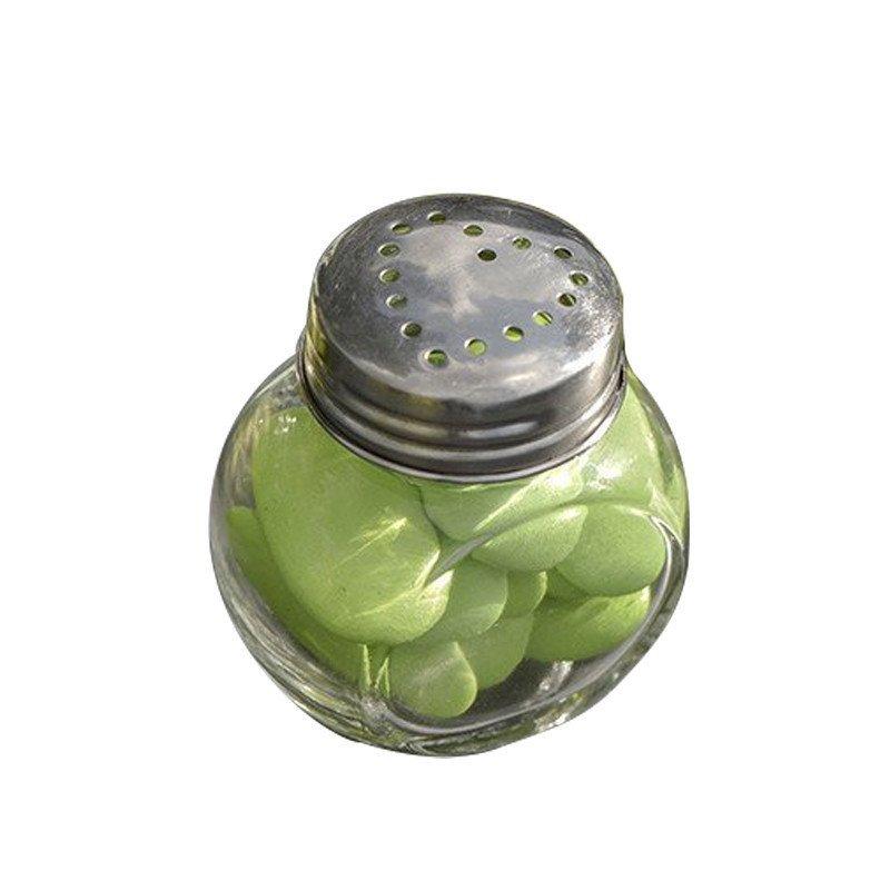Petit pot rond en verre contenant des dragées vert