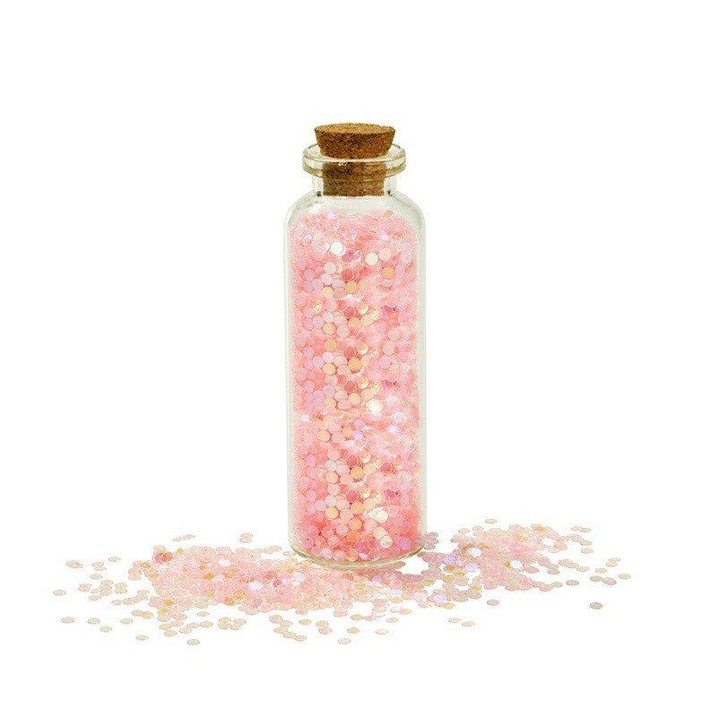 Tube de paillettes roses irisées